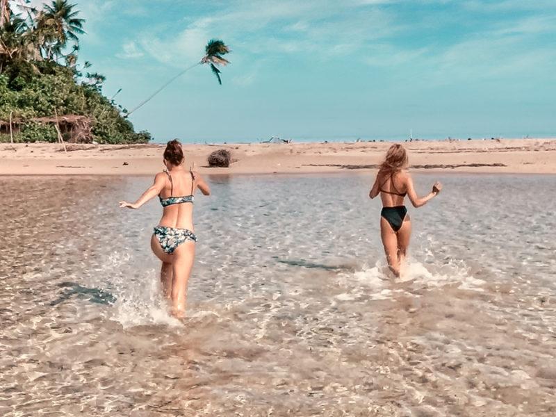 nikki and dior running to explore an uninhabited island